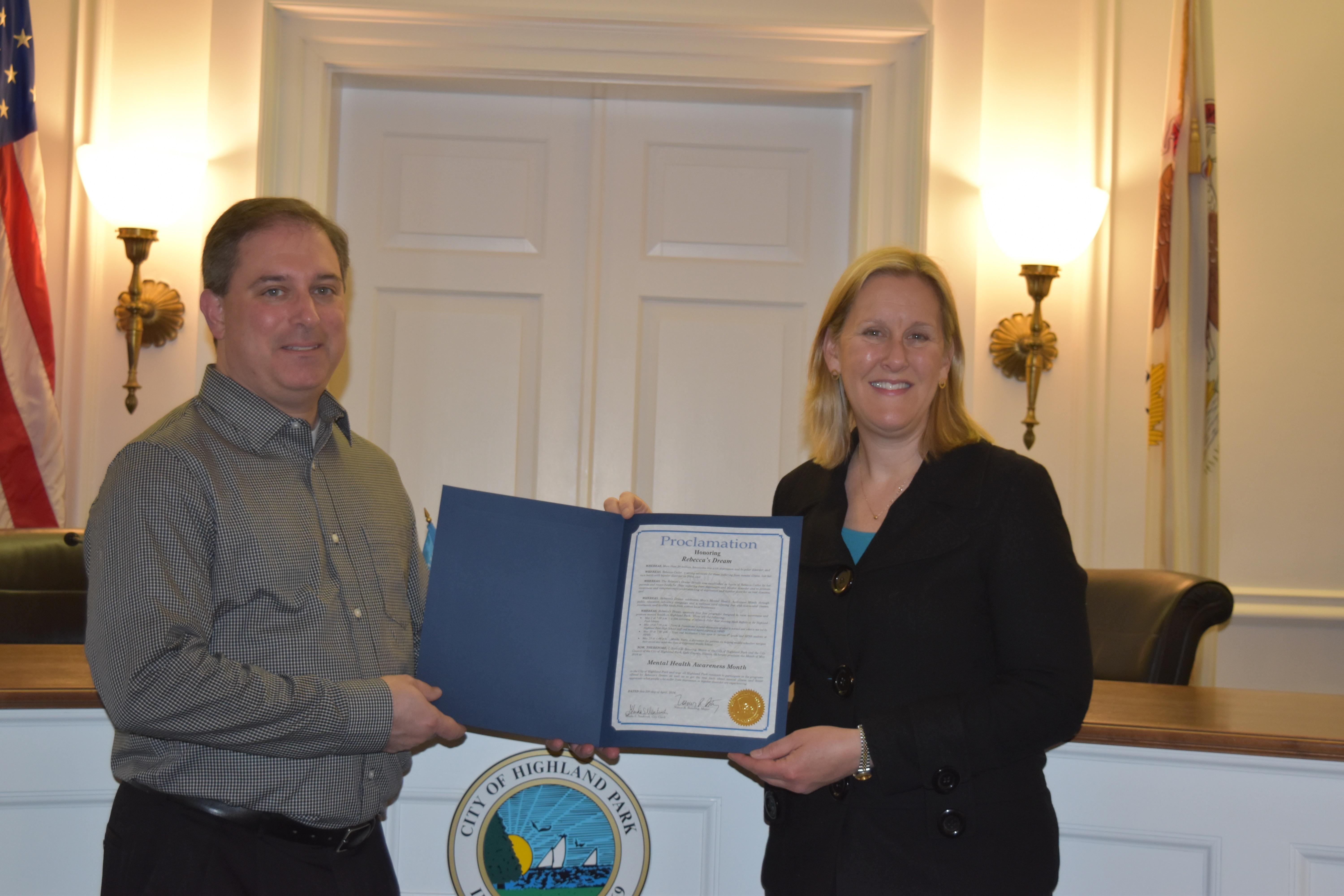 Brett Cutler accepting a Proclamation from Mayor Nancy R. Rotering, Mayor of Highland Park